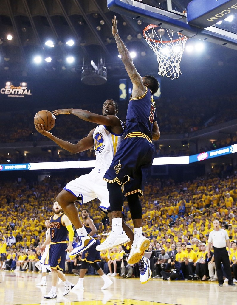 Harrison Barnes of the Warriors goes up against J.R. Smith. Ezra Shaw/Getty Images