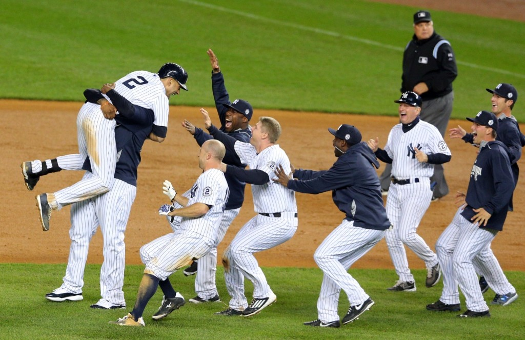 Derek Jeter with teammates after hitting a walk-off single against the Orioles. Brad Penner-USA TODAY Sports