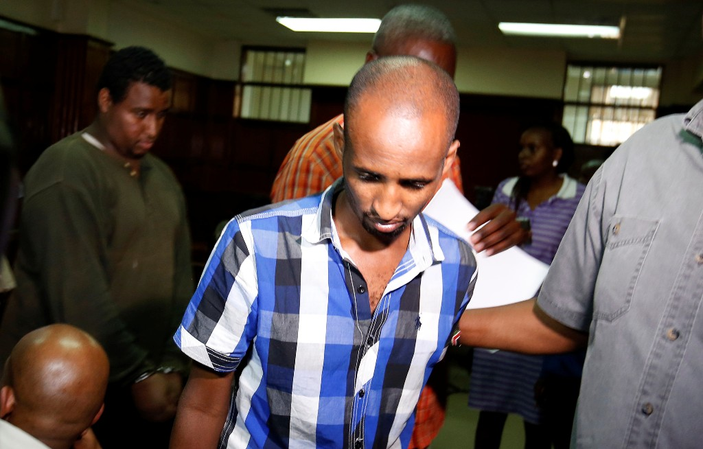 Osman Ibrahim is escorted from the Mililani Law Courts where he appeared as a suspect in connection with the attack at the DusitD2 complex, in Nairobi, Kenya January 18, 2019. REUTERS/Thomas Mukoya