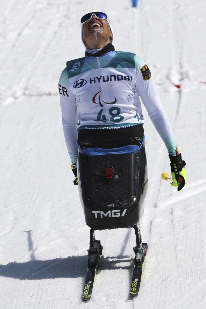 Andrea Eskau of Germany crosses the finish line to clinch silver in the Cross-Country Skiing Sitting Women's 12km. AP Photo/Ng Han Guan