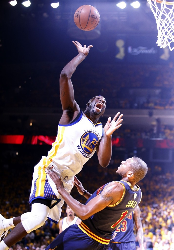 Draymond Green of the Warriors shoots over James Jones. Ezra Shaw/Getty Images