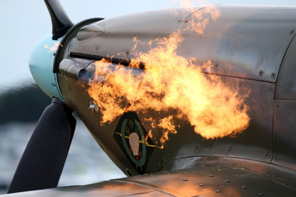 Flames roar from the exhaust of a Spitfire as it's engine is started, Tuesday, in Biggin Hill, England. Carl Court/Getty Images