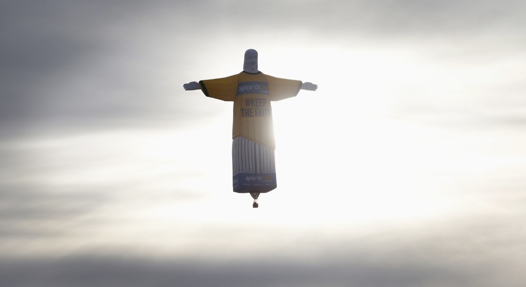 A hot air balloon in the shape of Brazil's Christ the Redeemer statue flies over the Sydney skyline, June 12. REUTERS/David Callow