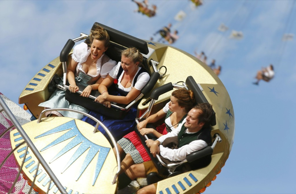 Visitors enjoy a fairground ride during the opening day of the 181st Oktoberfest in Munich. REUTERS/Michael Dalder