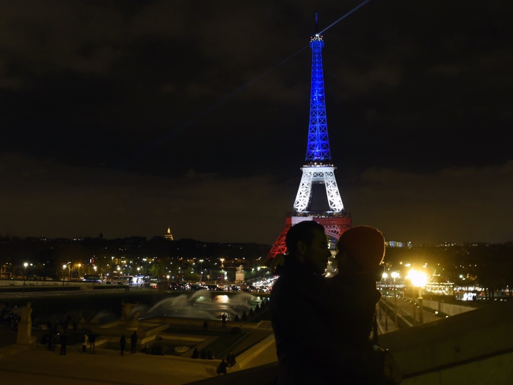 The Eiffel Tower illuminated with the colors of the French flag, Monday, in tribute to the victims of the November 13, 2015 Paris terror attacks. ALAIN JOCARD/AFP/Getty Images