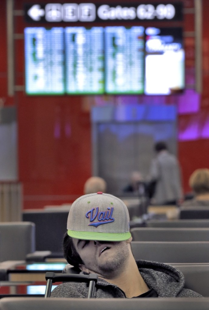A passenger waiting for a flight at Tampa International Airport. Most flights to the northeast were canceled Tuesday due to major storm. AP Photo/Chris O'Meara