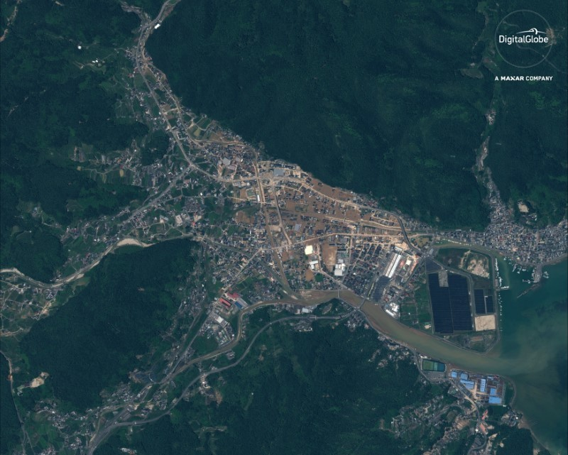 "A satellite image of an overview of Yasuura, Japan ""after the floods"" captured July 10, 2018. Satellite image ©2018 DigitalGlobe, a Maxar company/Handout via REUTERS"