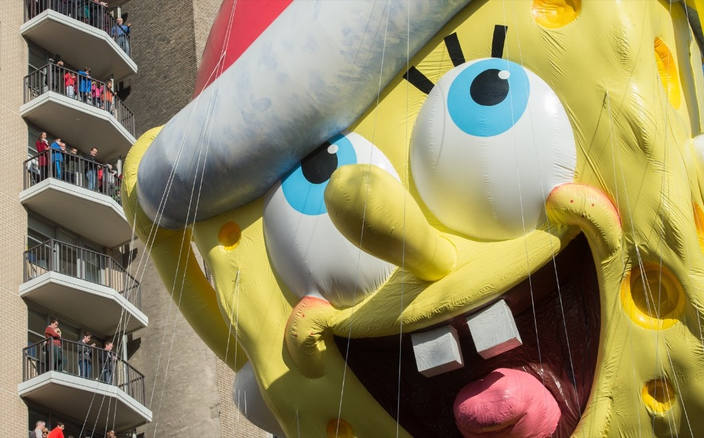 Spectators watch as the balloon of Spongebob Squarepants is moved down Central Park West during the Macy's Thanksgiving Day Parade, Thursday, in New York. AP Photo/Bryan R. Smith
