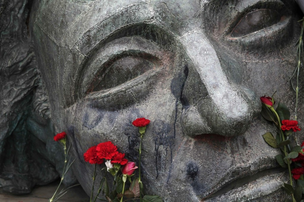 Flowers are placed on a monument inside the Athens Polytechnic school on 41st anniversary of a 1973 student uprising against the then military ruling junta. REUTERS/Yorgos Karahalis