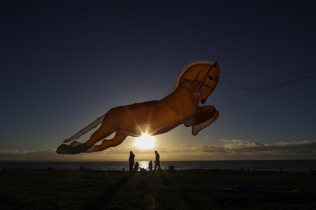 A horse-shaped kite named Goldey takes to the sky in Crosby, England. Christopher Furlong/Getty Images