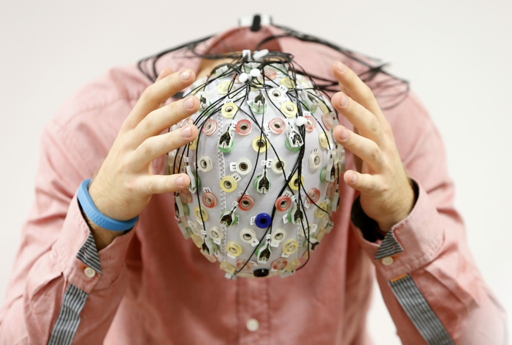 Niklas Thiel with an electroencephalography cap, which measures brain activity, at the Technische Universitaet Muenchen in Garching, Germany. REUTERS/Michaela Rehle