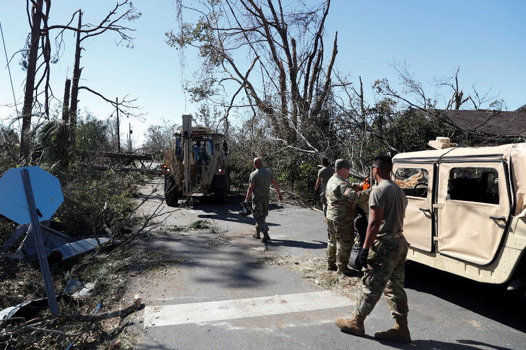 Soldiers of the Florida National Guard clear downed trees in the aftermath of Hurricane Michael in Parker, Florida, U.S., October 13, 2018. REUTERS/Terray Sylvester