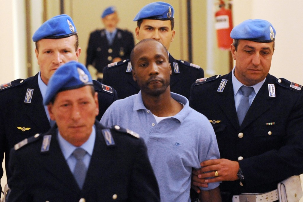 One of the three suspects in the murder of British student Meredith Kercher, Rudy Guede from the Ivory Coast leaves at a court hearing in Perugia on Sept. 27, 2008. TIZIANA FABI/AFP/Getty Images