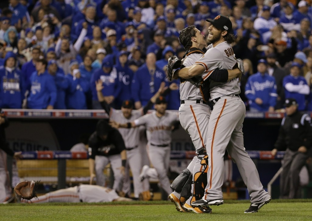 Giants Madison Bumgarner and catcher Buster Posey celebrate after winning Game 7 of the World Series against the Royals. AP Photo/David J. Phillip