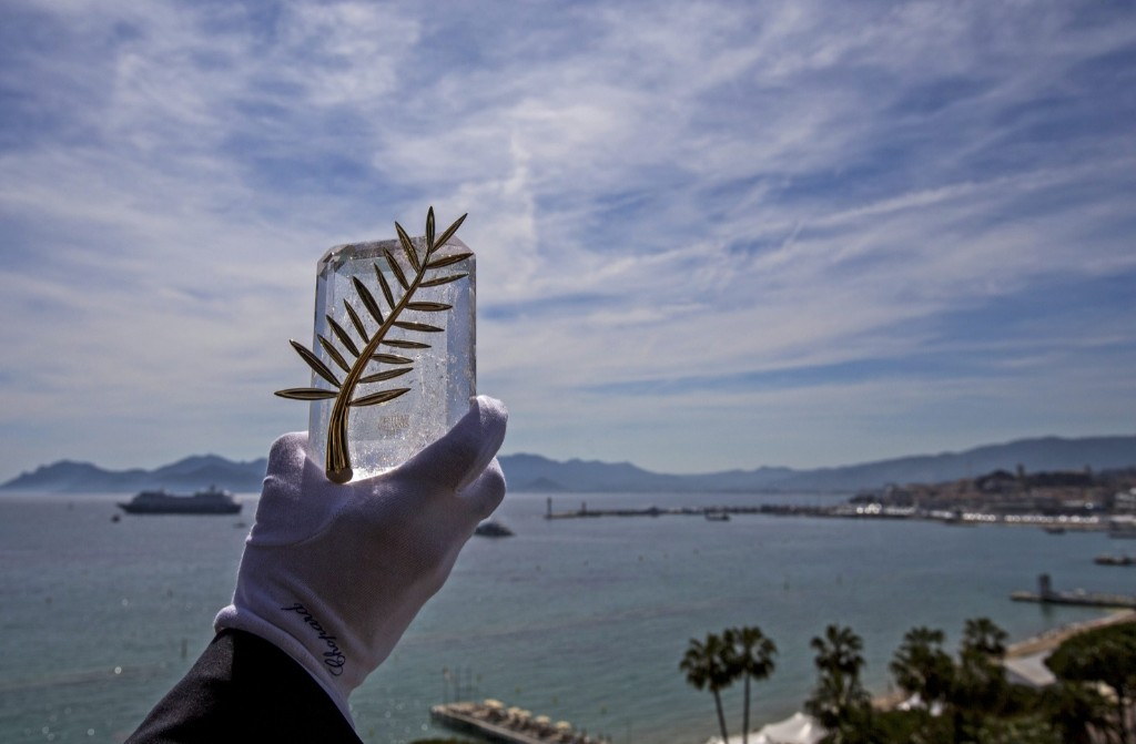 A Chopard representative displays the Palme d'Or, the highest prize awarded to competing films, before the start of the 68th Cannes Film Festival. REUTERS/Yves Herman