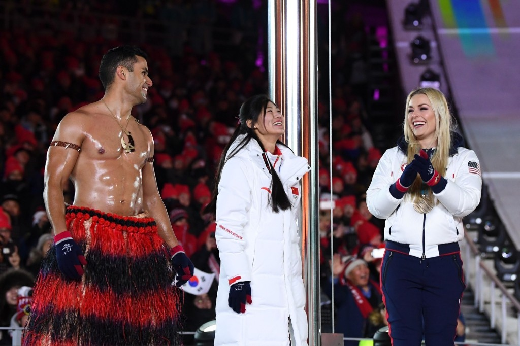 Tonga's Pita Taufatofua, China's Liu Jiayu and USA's Lindsey Vonn on stage during the closing ceremony. JONATHAN NACKSTRAND/AFP/Getty Images