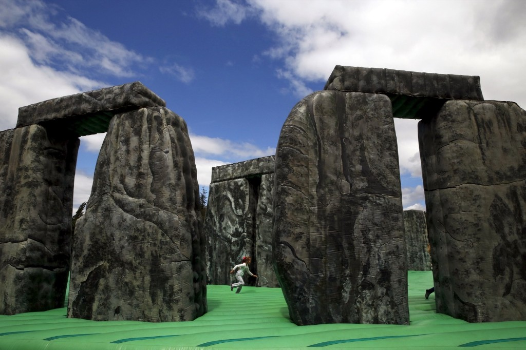 A girl plays on an inflatable replica of Stonehenge at a public park in Mostoles, Spain. REUTERS/Susana Vera
