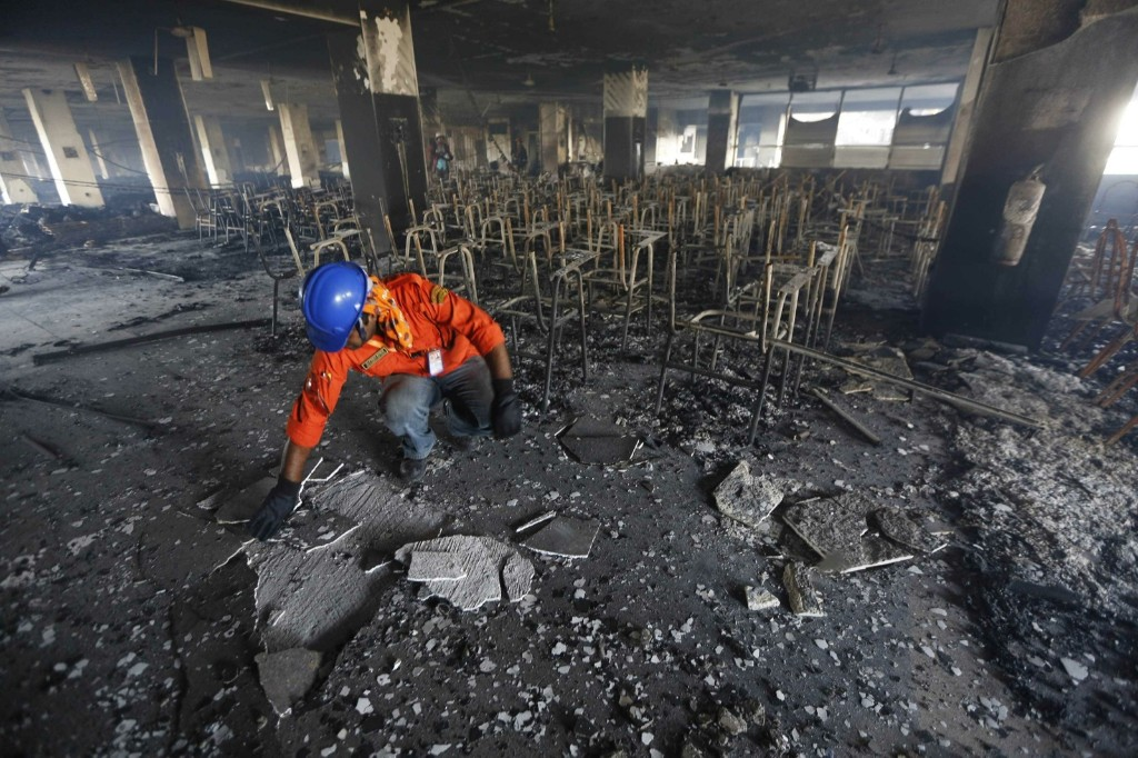 A firefighter inspects the damage at the Bangladesh Standard Group garment factory last Friday. REUTERS/Andrew Biraj