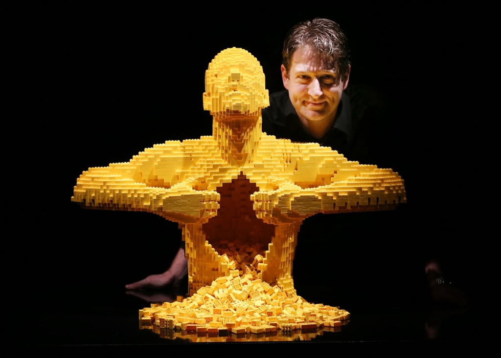 Artist Nathan Sawaya stands with his sculpture 'Yellow' at the Art of Brick Exhibition in London. Peter Macdiarmid/Getty Images