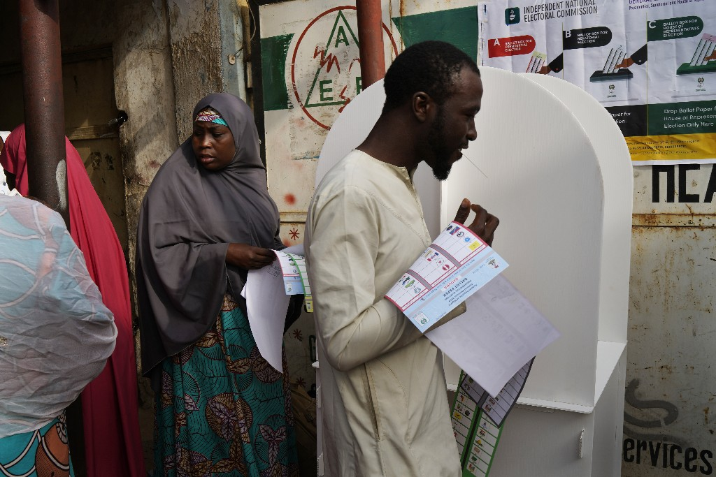Nigerians vote in Kaduna, Nigeria, Saturday Feb. 23, 2019. Incumbent President Muhammadu Buhari is to face opposition presidential candidate Atiku Abubakarin in the presidential election. (AP Photo/Jerome Delay)