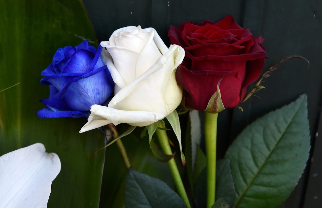 Tricolor roses in front of the French consulate in Krakow. EPA/JACEK BEDNARCZYK