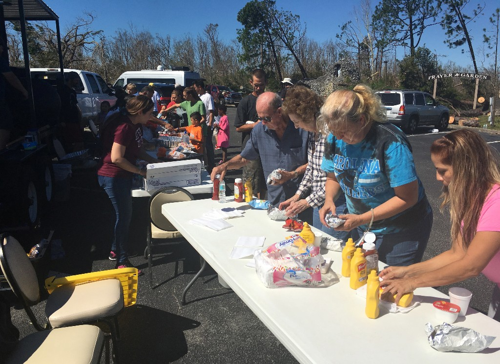 Catholic Church volunteers serve lunch to people affected by Hurricane Michael, in Callaway, Florida, U.S., October 13, 2018. REUTERS/Rod Nickel