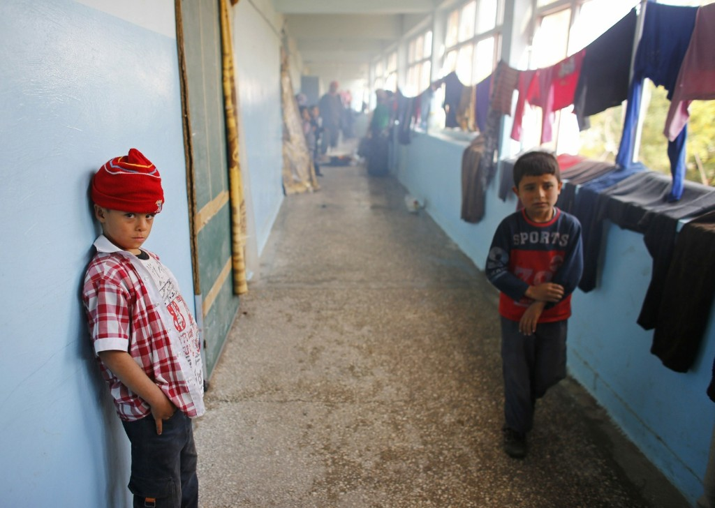 Kurdish refugee boys from Kobani at makeshift housing in an empty school building in Suruc. REUTERS/Osman Orsal