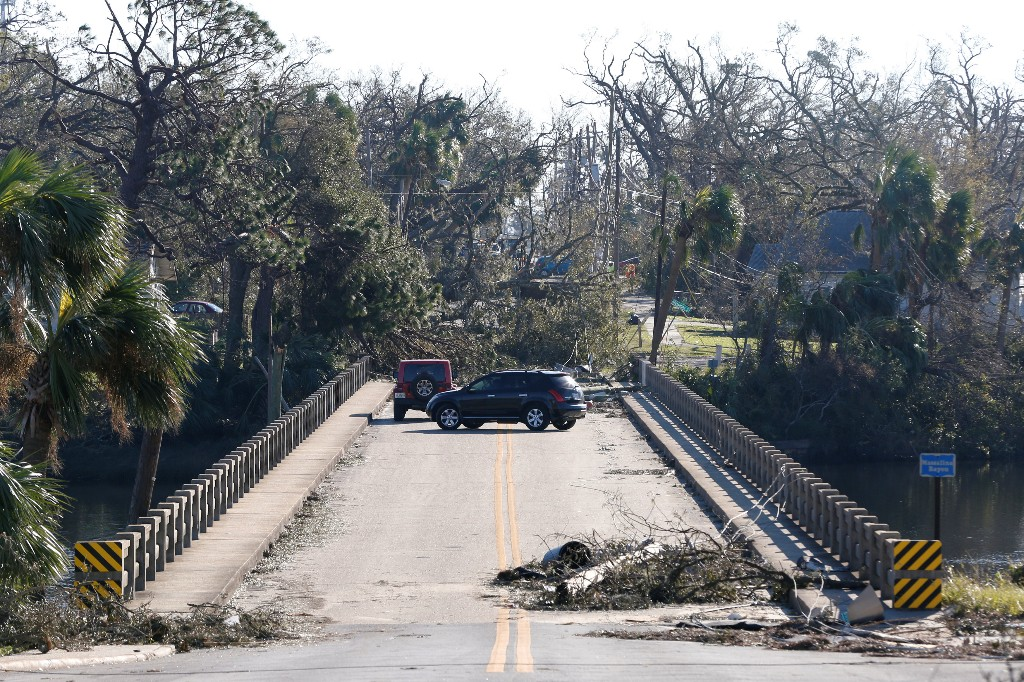 Drivers turn around on a bridge blocked by debris in the aftermath of Hurricane Michael in Panama City, Florida, U.S., October 13, 2018. REUTERS/Terray Sylvester
