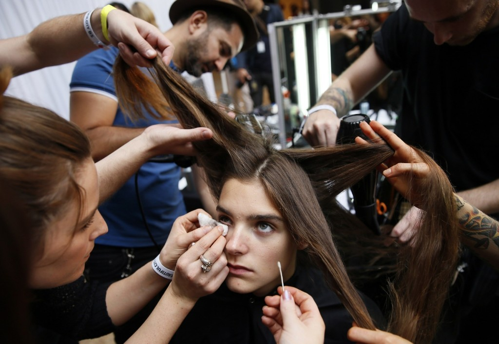Backstage before the Paul Smith Spring/Summer collection presentation. REUTERS/Stefan Wermuth