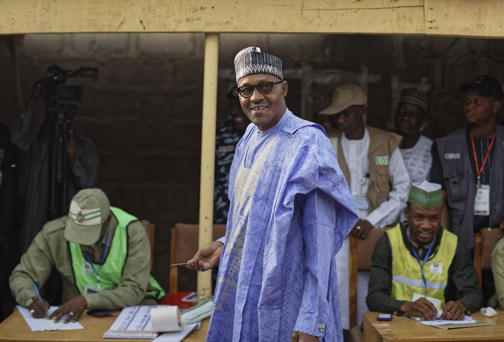 Nigeria's President Muhammadu Buhari prepares to cast his vote in his hometown of Daura, in northern Nigeria Saturday, Feb. 23, 2019. Nigerians are going to the polls for a presidential election Saturday, one week after a surprise delay for Africa's largest democracy. (AP Photo/Ben Curtis)