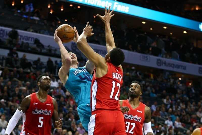 Feb 22, 2019; Charlotte, NC, USA; Charlotte Hornets center Cody Zeller (40) shoots the ball against Washington Wizards forward Jabari Parker (12) in the second half at Spectrum Center. Mandatory Credit: Jeremy Brevard-USA TODAY Sports