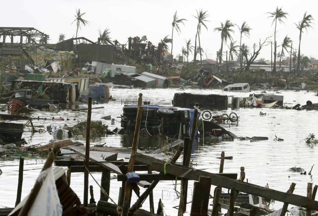 Vehicles float in waters Sunday following the devastation brought about by typhoon Haiyan. AP Photo/Bullit Marquez
