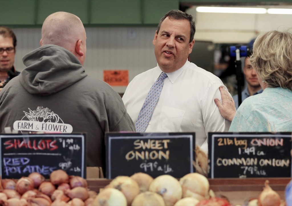 Republican presidential candidate Chris Christie during a campaign stop at the Farm & Flower Market in Manchester, N.H. AP Photo/Jim Cole