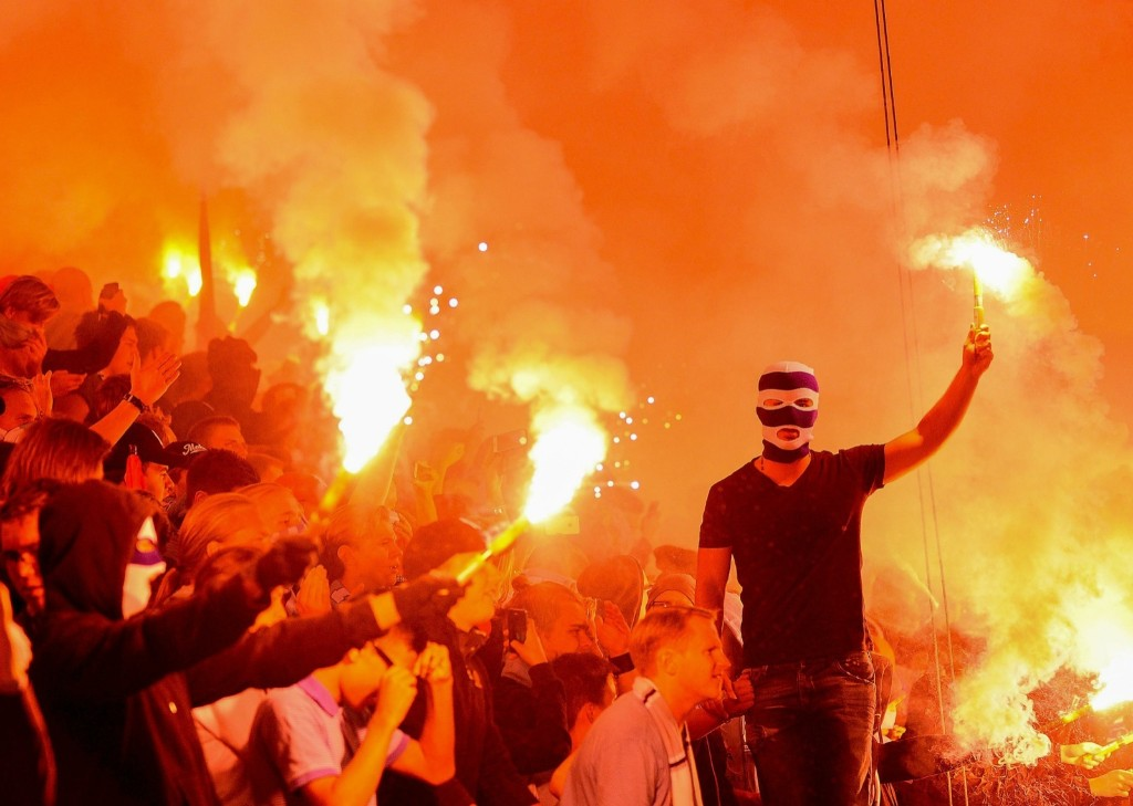 Malmo supporters celebrate winning Champions League playoff match against Salzburg. REUTERS/Bjorn Lindgren/TT News Agency