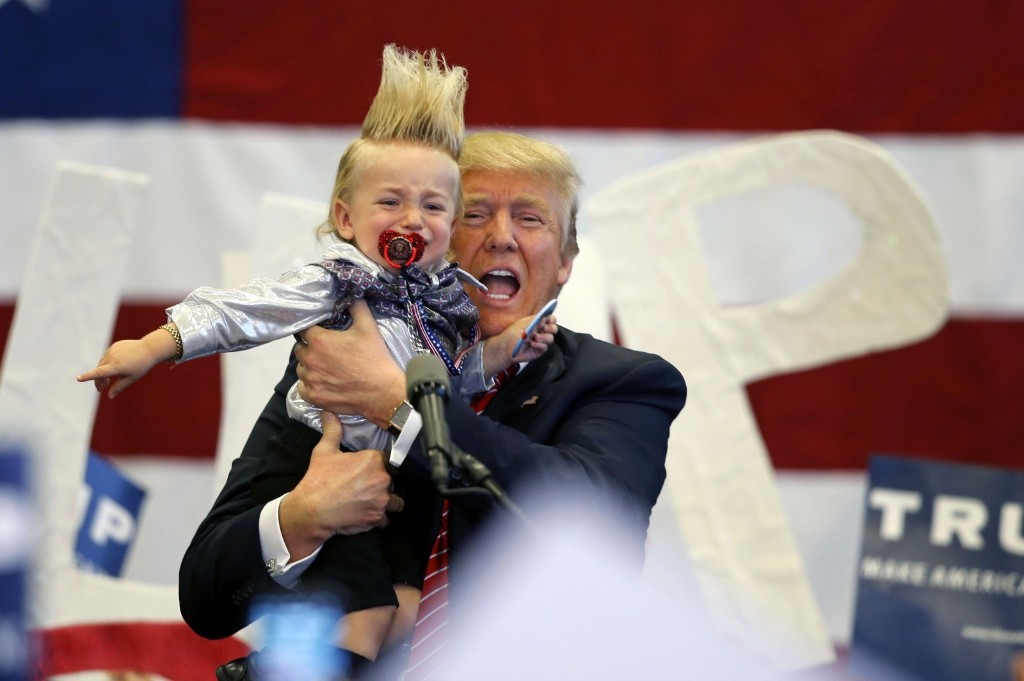 Donald Trump holds up a child he pulled from the crowd at a campaign rally in New Orleans. AP Photo/Gerald Herbert