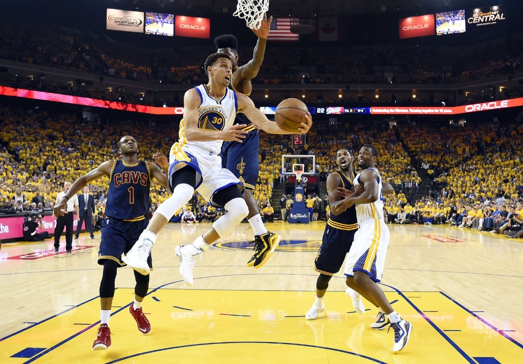 Warriors Steph Curry drives to the basket against Cavaliers guard J.R. Smith and James Jones. Bob Donnan-USA TODAY Sports