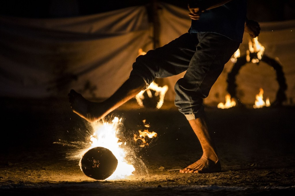 Locals play a game of fire football, known as 'bola api', with a coconut soaked in kerosene and set on fire, during celebrations of Indonesia's National Independence Day. Ulet Ifansasti/Getty Images