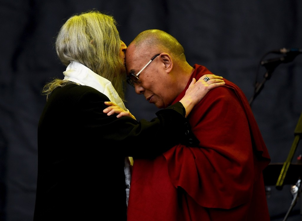 Patti Smith kisses the Dalai Lama on the Pyramid stage during Glastonbury. REUTERS/Dylan Martinez