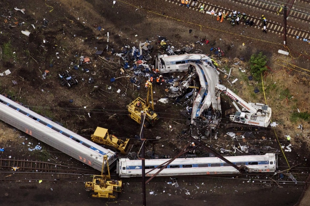 Emergency workers look through the remains of a derailed Amtrak train in Philadelphia. REUTERS/Lucas Jackson
