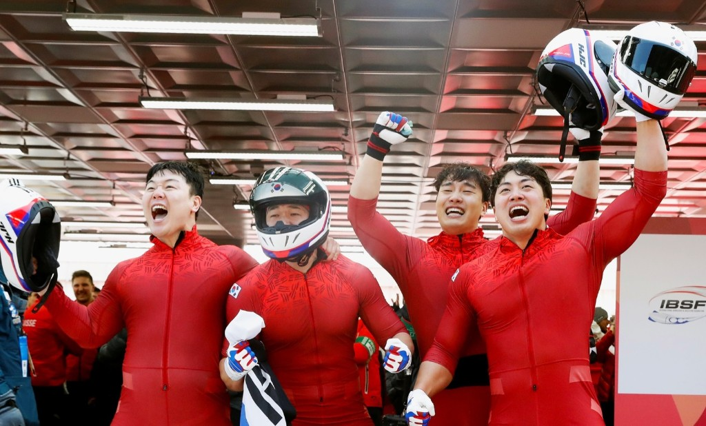 Won Yun-jong, Jun Jung-lin, Seo Young-woo and Kim Dong-hyun of South Korea after taking silver in the bobsleigh. REUTERS/Arnd Wiegmann