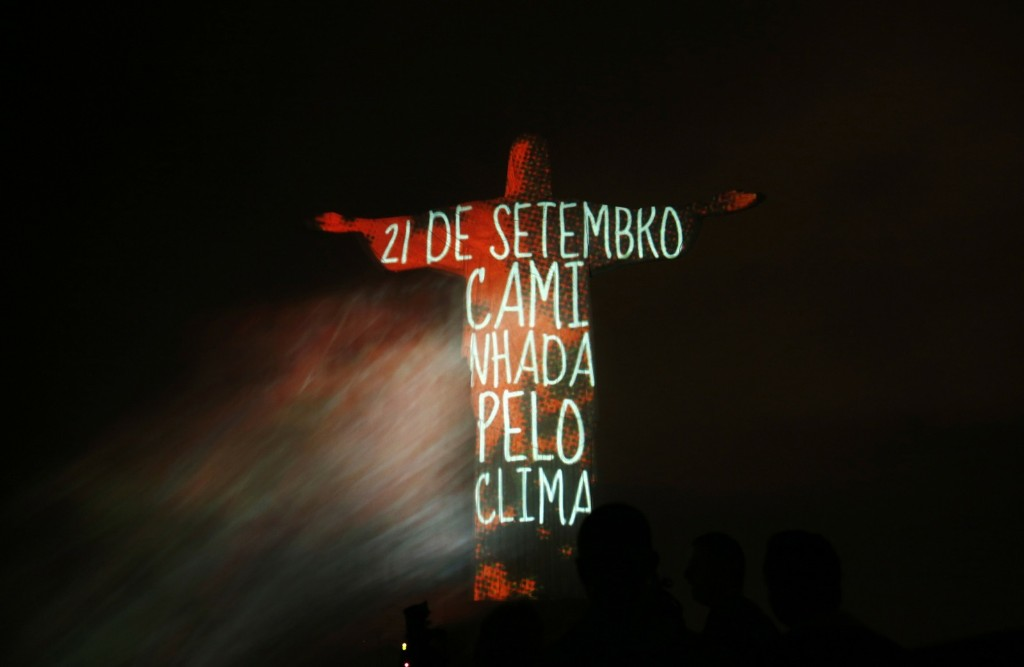 Christ the Redeemer in Rio is lit up with a message announcing a global mobilization for climate. REUTERS/Pilar Olivares