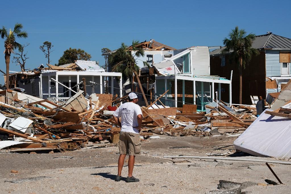 A man walks along a street following Hurricane Michael in Mexico Beach, Florida, U.S., October 12, 2018. REUTERS/Carlo Allegri