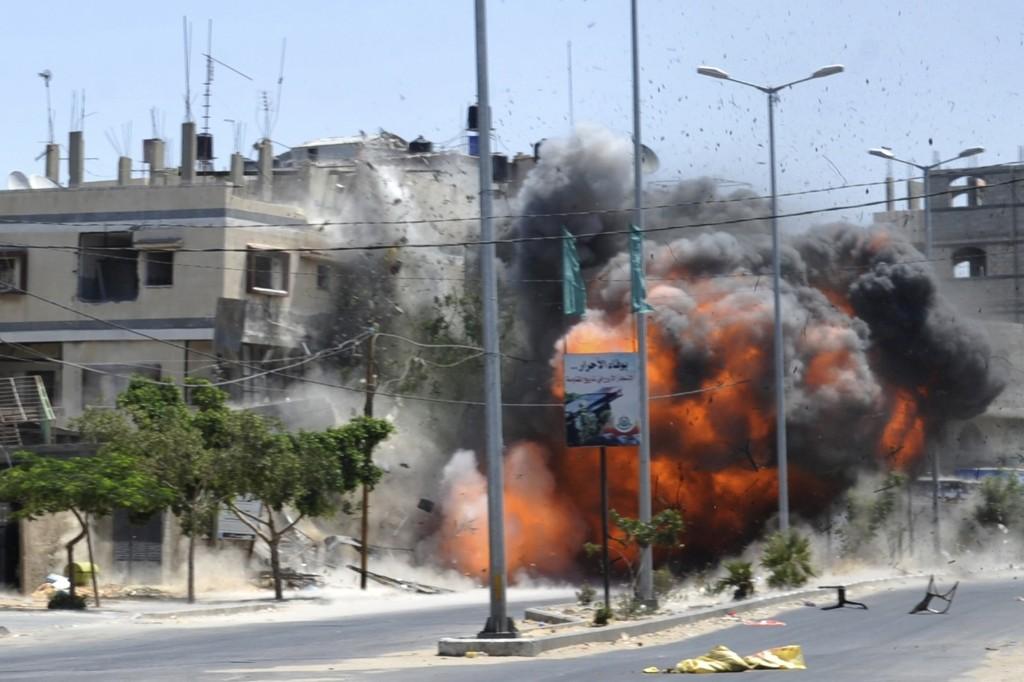 An explosion in Gaza City. REUTERS/Ezz Zanon