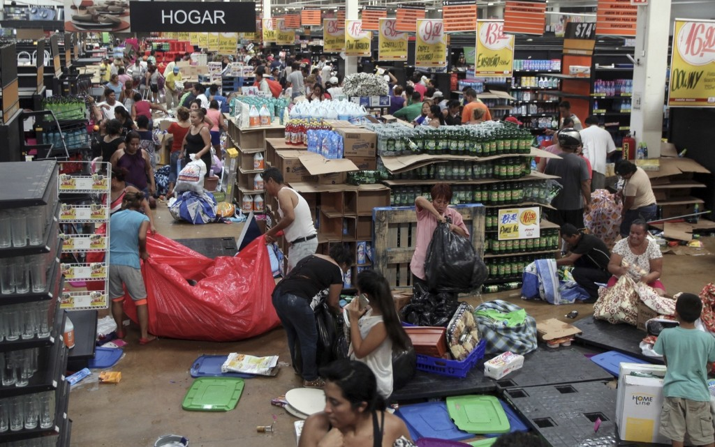 People ransack a store in Veracruz, Mexico. Anger over gasoline price hikes is fueling protests and looting. AP Photo/Felix Marquez