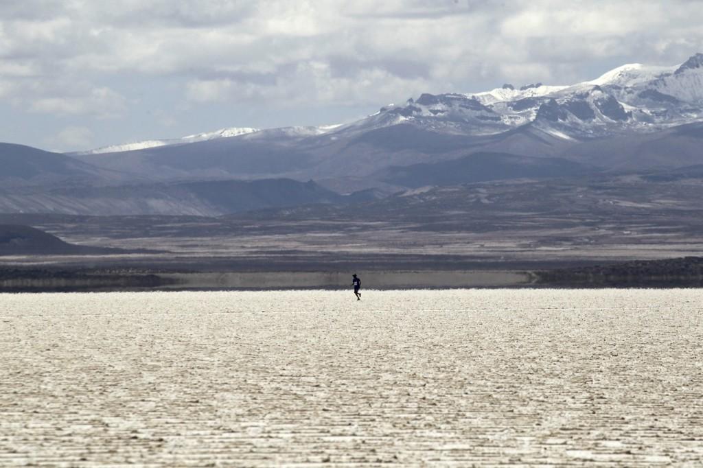 A participant runs across the salt flat during K42 race in Uyuni, Bolivia. REUTERS/David Mercado