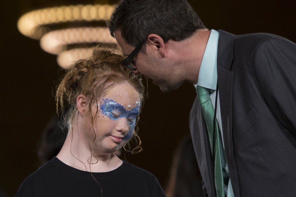 Madeline Stuart, an Australian model with Down Syndrome, and JD Meyer-Vermeulen talk after presenting the Hendrik Vermeulen label during the FTL Moda presentation. REUTERS/Andrew Kelly