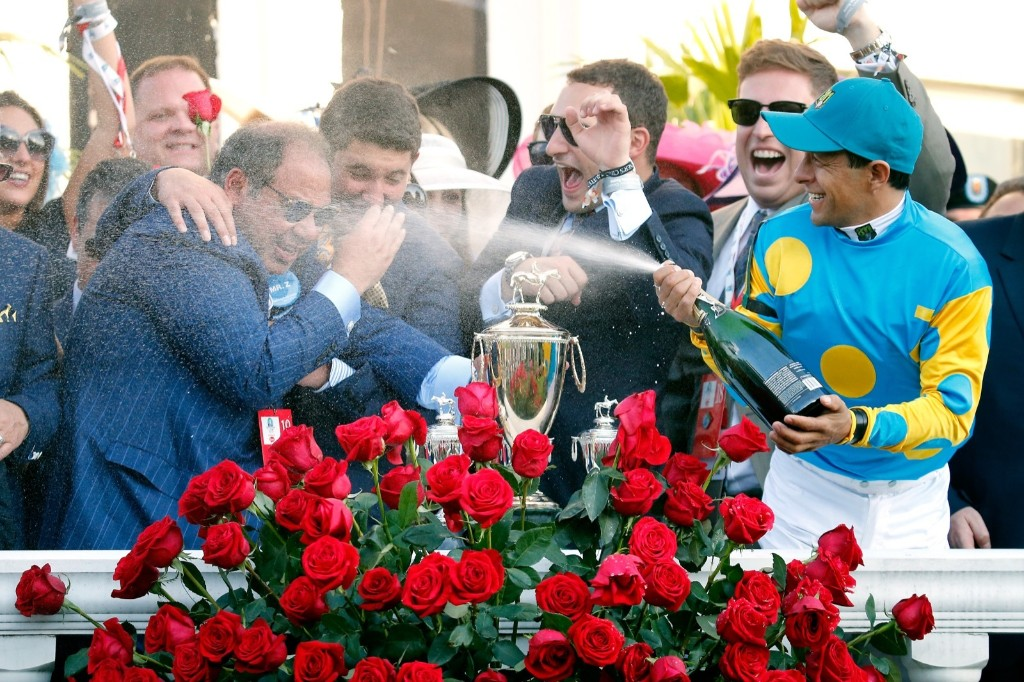 Jockey Victor Espinoza of American Pharoah celebrates by spraying owner Ahmed Zayat with champagne in winners circle after winning the 141st running of the Kentucky Derby, at Churchill Downs, Saturday, in Louisville. Rob Carr/Getty Images