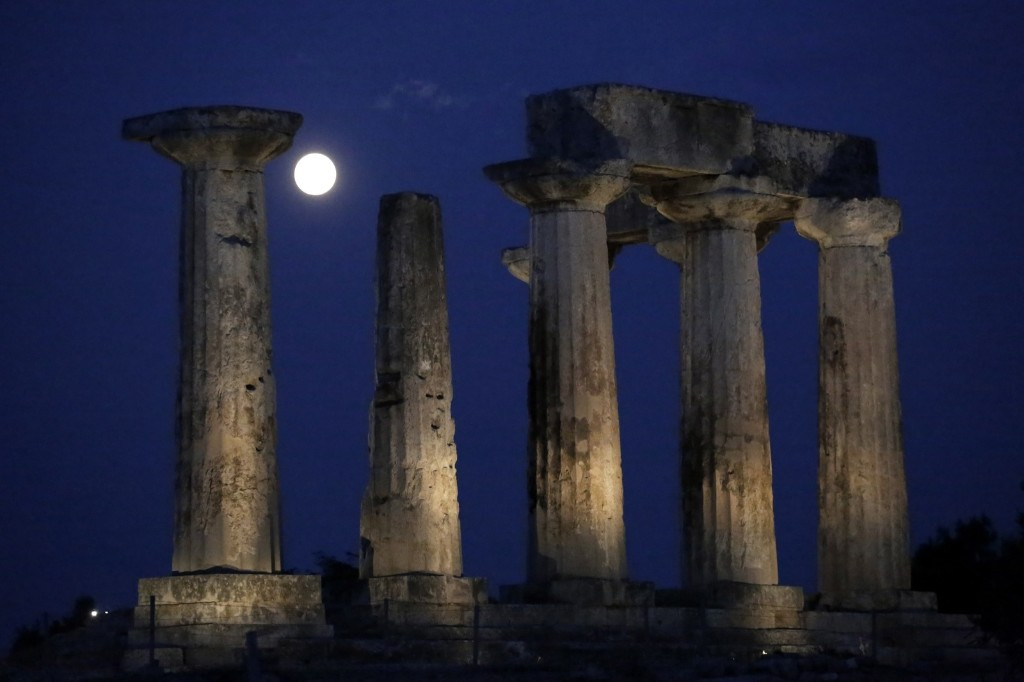Supermoon rises in front of Apollo's temple in ancient Corinth, southwest of Athens. AP Photo/Petros Giannakouris