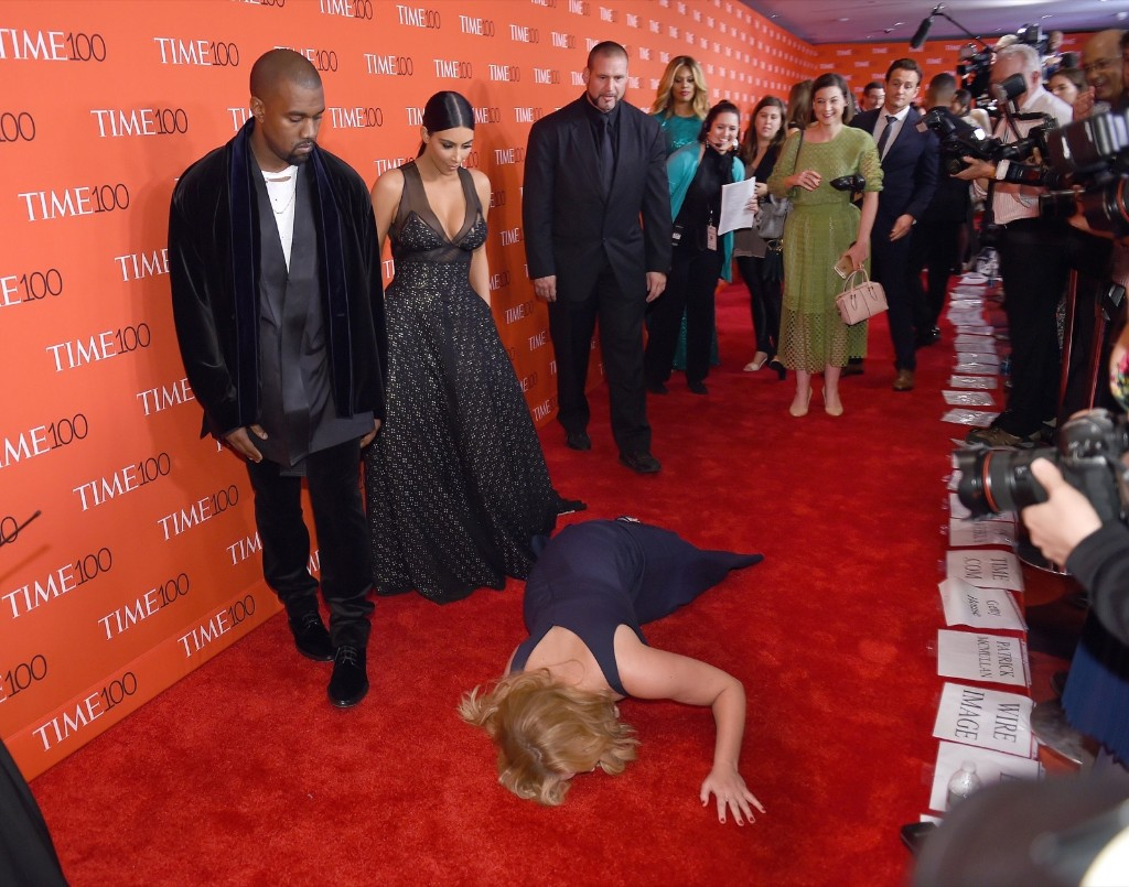 Honoree and comedian Amy Schumer pretends to fall on the ground in front of honorees Kim Kardashian and Kanye West at the Time 100 Gala celebrating the Time 100 issue of the Most Influential People, in New York, April 21. Timothy A. Clary/AFP/Getty Images