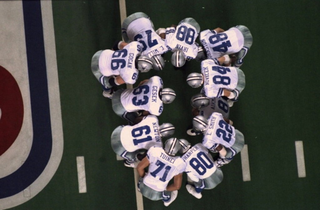 The Cowboys huddle during Super Bowl XXVIII against the Bills at the Georgia Dome, Jan. 1994. Cowboys won, 30-13. Chuck Solomon/Sports Illustrated/Getty Images